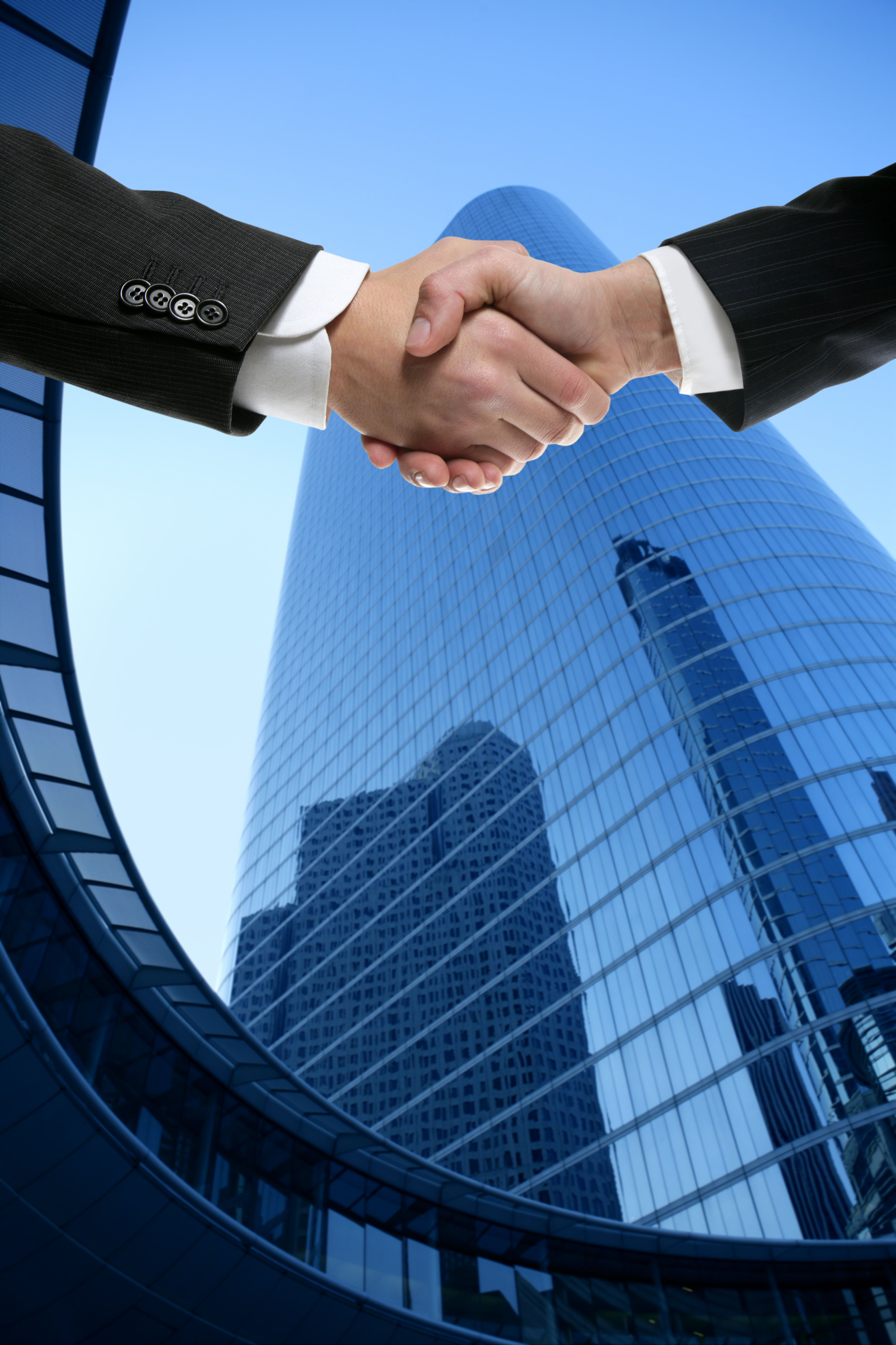 businessman-partners-shaking-hands-with-suit